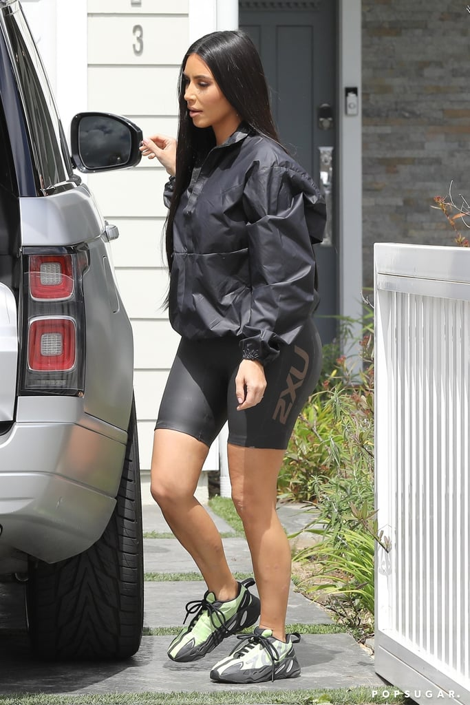 Kim Kardashian hasn't moved on from the bike short trend just yet. (She's partially responsible for getting it going, after all.) On March 28, the reality star was spotted out in Los Angeles wearing an athleisure outfit consisting of a black windbreaker, Yeezy 2XU scuba cycling shorts, and chunky neon sneakers also from her husband's namesake brand. While Kim's exact shorts are only currently available in limited sizes, the trend has become so ubiquitous that there are plenty of other options. Check out Kim's sporty look ahead, and shop similar cycling shorts.       Related:                                                                                                           I Wore Biker Shorts 3 Different Ways, and I Totally Get the Hype Now