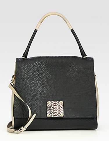 This Furla exclusively for Saks Fifth Avenue Capri medium shopper ($1,095) feeds into the colorblock trend in the most subtle way. And how cool is that snap closure?