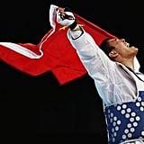 Taekwondo fighter Xiaobo Liu of China celebrated his win.