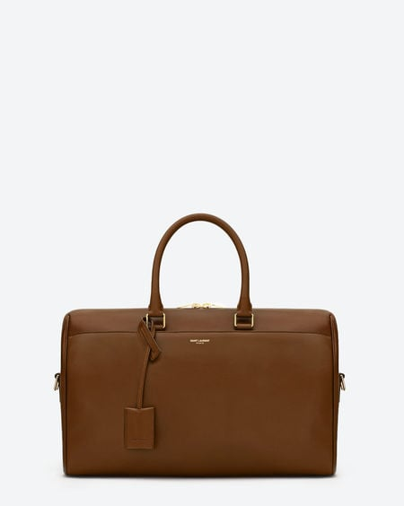 Duffle 12h in cognac calfskin leather with suede lining ($2,650).