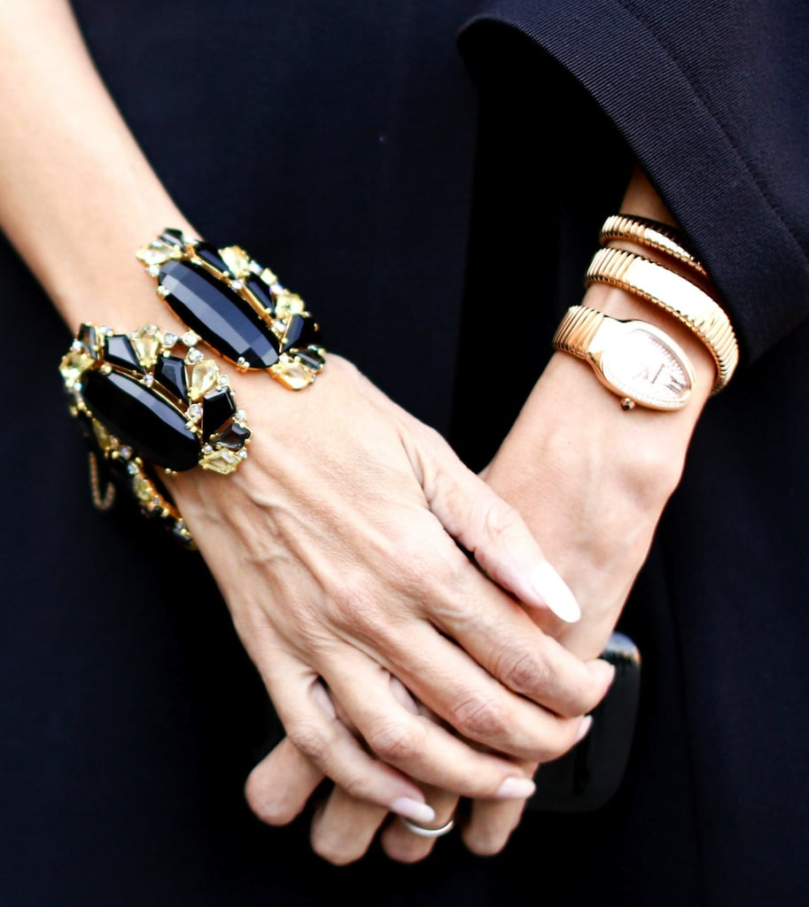 A decadent stone bracelet and snake wrap watch emote major glam factor.