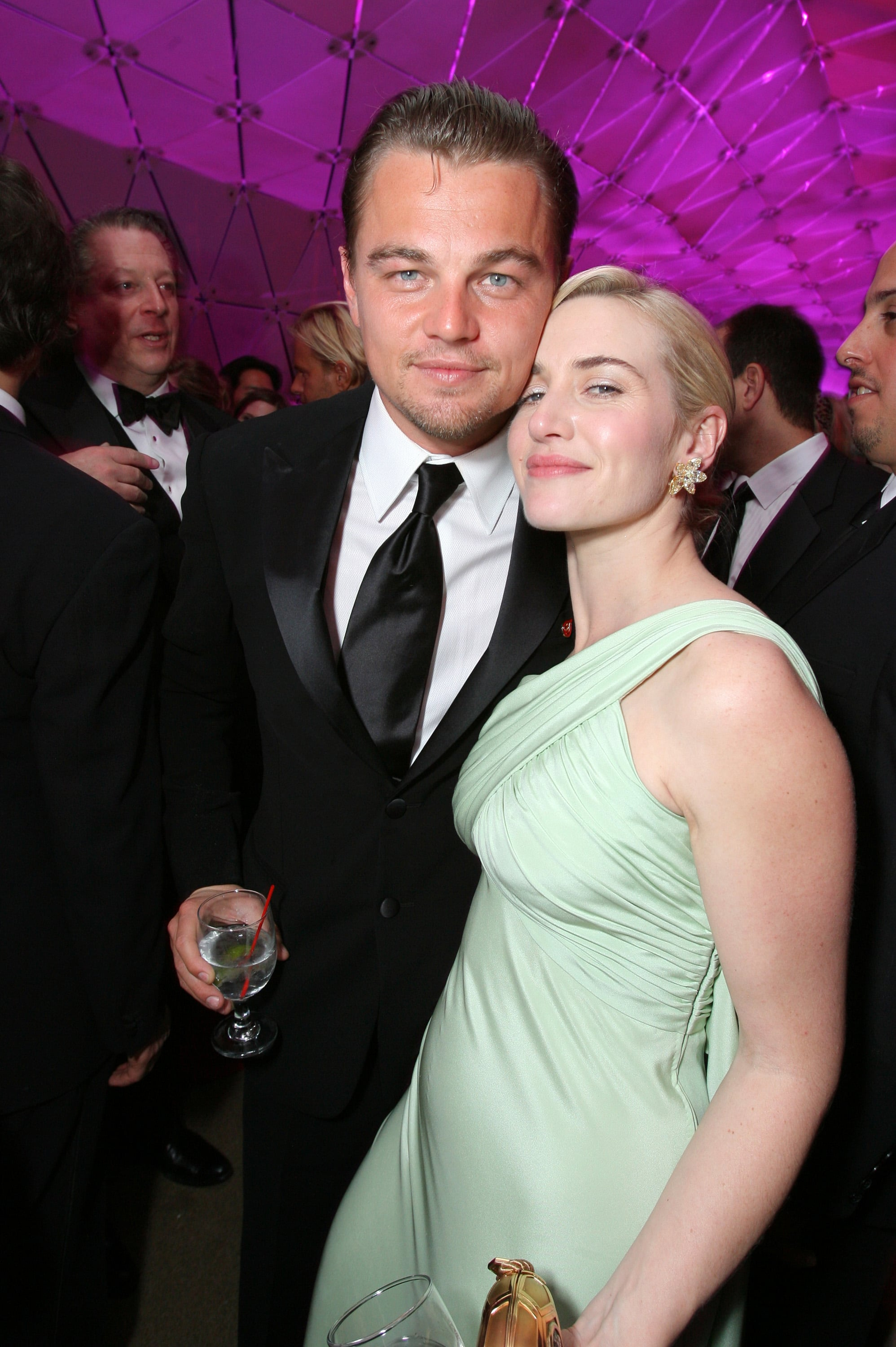 """They met up multiple times throughout the season and wrapped up the excitement at Vanity Fair's annual Oscars party, where Kate helped Leo celebrate The Departed's best picture win.  Later that year — 10 years after their Titanic start — they got back together in front of the cameras to film 2008's Revolutionary Road. Kate shared that their background helped them during filming, especially since the director happened to be Kate's then-husband, Sam Mendes. Kate confirmed that Leo's and her """"relationship predates my relationship with Sam, and Sam always loved that,"""" which made working with both the men in her life even easier."""