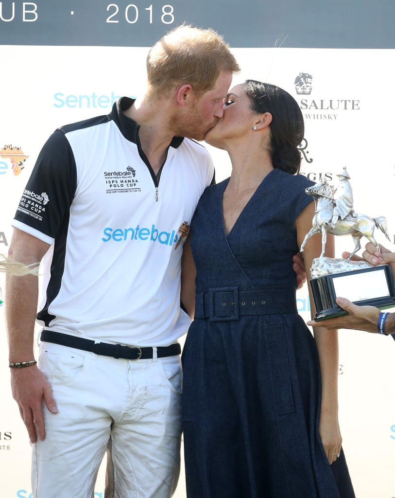 "Prince Harry competed in the Sentebale Polo Cup in Windsor on Thursday, and his beaming bride, Meghan Markle, was on hand for the fun event. After taking part in the match, which was held at the Royal County of Berkshire Polo Club, Harry met up with Meghan for a romantic and congratulatory smooch while posing for photos with Sentebale ambassador Nacho Figueras; his wife, Delfina; the charity's CEO, Cathy Ferrier; and its chairman, Johnny Hornby.  It's certainly not the first bit of PDA we've seen from the couple, who are notoriously adorable when it comes to showing their affection for each other. In fact, royal photographer Mark Stewart recently revealed that Harry and Meghan ""don't mind showing their emotions,"" and a former palace spokesperson added that ""Meghan is used to being touchy-feely, and Harry is the same."" Keep reading to see their latest cute kiss, then look back on their epic wedding-day PDA.      Related:                                                                                                           The Sweet Gesture That Proves Meghan Markle and Prince Harry Will Always Have Each Other's Backs"