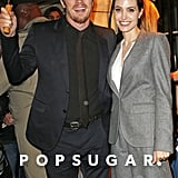 Garret Hedlund graciously held an umbrella for Angelina Jolie at Tuesday's Unbroken luncheon in NYC.