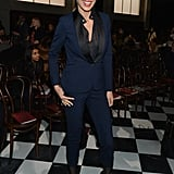 Petra Nemcova suited up in a menswear-inspired navy and black pantsuit at the Tommy Hilfiger show.