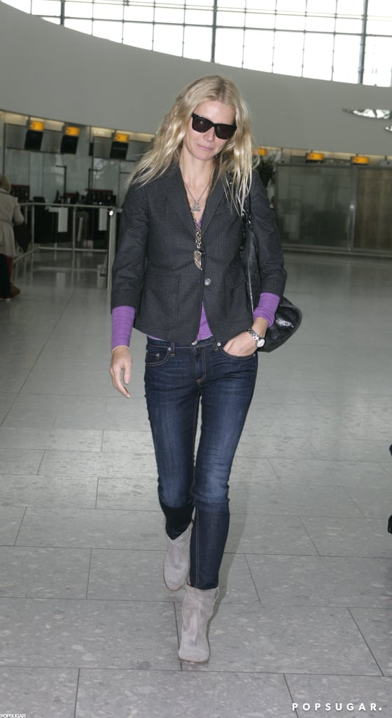 """Gwyneth Paltrow flashed a little smile as she walked through London's Heathrow airport today. She's off on a trip after a big announcement last week. Gwyneth Paltrow is the new face of Hugo Boss and will front the new campaign for their Boss Nuit Pour Femme fragrance. The ads are scheduled to come out later this year in August and September. Speaking about their new collaboration, Gwyneth told WWD, """"To me, the Boss woman is driven, ambitious, and goes after what she wants, but she balances being strong and very feminine at the same time — characteristics that I strive towards in my own life."""" Gwyneth was in the UK following a recent stint in NYC, where she attended the Met Gala. Gwyneth wore a Prada dress that showed a lot of skin, including her Tracy Anderson-toned legs. Gwyneth was pictured making the social rounds inside the Metropolitan Museum of Art, saying hello to pals like Beyoncé Knowles and Justin Timberlake. Her husband Chris Martin has had an equally travel-filled two weeks as he tours with Coldplay. He's due in Portugal Friday for a quick tour of Europe that will also take him to Spain, France, Italy, and Switzerland."""