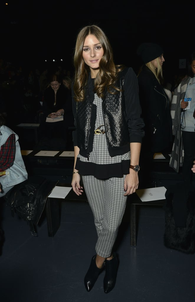 Olivia Palermo paired checkered pants with a matching top, then layered on a metallic black jacket at the Tibi show.