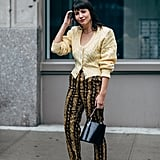 Work a bold-shouldered, vintage-inspired cardigan buttoned-up with animal print pants and strappy heels. This no-fuss look, with nothing underneath, is decidedly sexy.