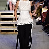 Kendall's full outfit at Givenchy included a white top and full-leg black trousers.
