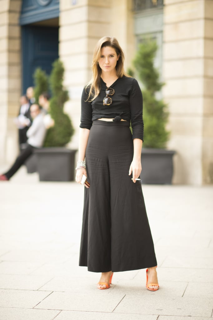 We're obsessed with this black-on-black look. Thanks to flowy high-waist trousers and citrus heels, this look is still decidedly summery.