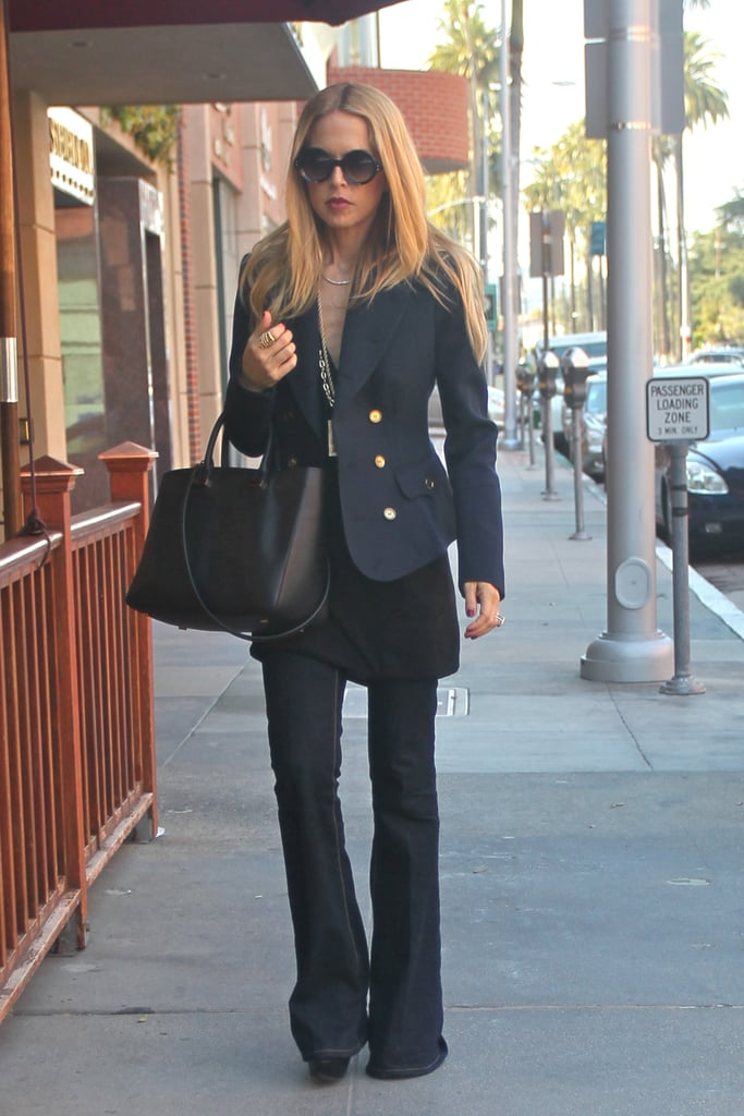 Rachel Zoe worked her signature style angle in a pair of dark flares and a classic blazer.