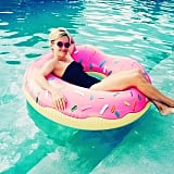 """Reese captioned this pool snap, """"#DonutWorryBeHappy?!"""""""