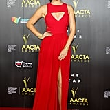 Grace Huang played the vixen in a red gown, that, despite reaching to the floor, flashed plenty of leg.