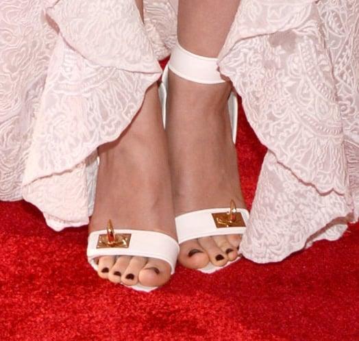 Rooney Mara wore white Givenchy sandals.