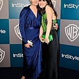 Emily Deschanel and Zooey Deschanel show the sisterly love at the Golden Globes.
