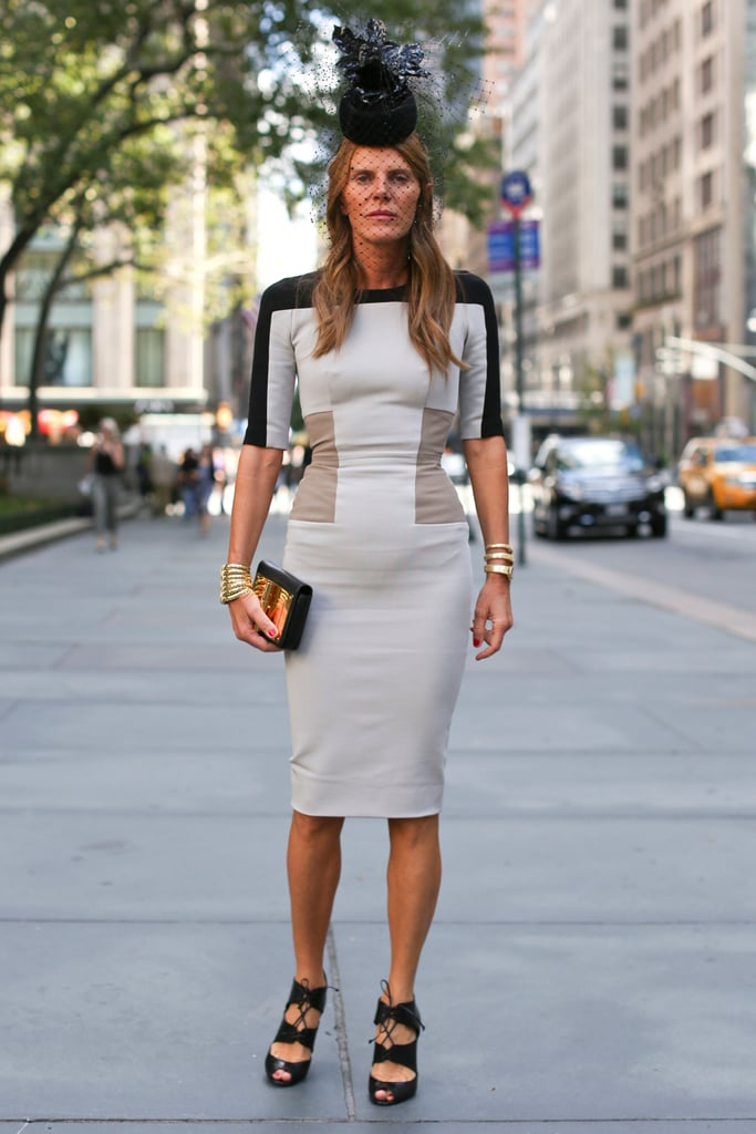 Anna Dello Russo gave a body-con sheath her signature flair with a headpiece and lace-up heels.