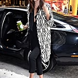 Miranda Kerr looked almost ready for Fall in a printed coat, black skinnies, and sleek heels.