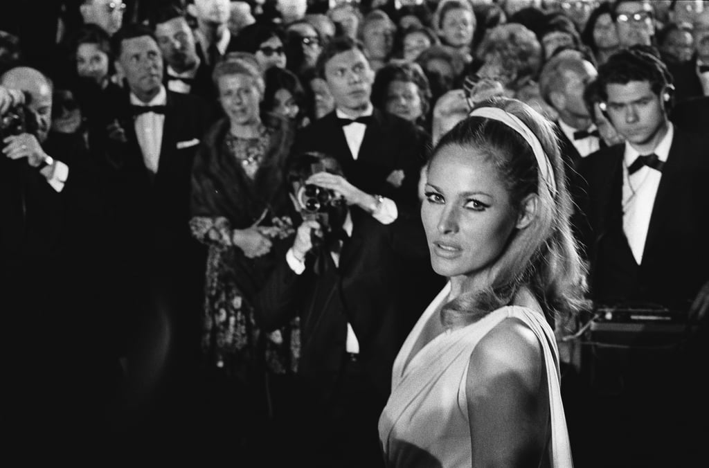 Ursula Andress, who played Bond girl Honey Ryder in 1962's Dr. No, stunned on the red carpet at the 1965 film festival.