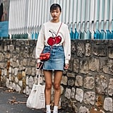 A fruit-print top is so playful with a denim skirt.