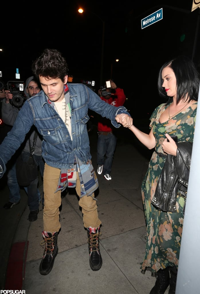 Katy Perry held hands with John Mayer following a dinner date at Osteria Mozza in LA last night. The couple are staying put on the West Coast for the time being after celebrating Christmas with her parents. It seems John and Katy's romance is going strong. They connected last Summer and, after a brief break, reconciled in the Fall. They've been having lots of fun during relatively slow periods work-wise, taking in Broadway shows, watching a Rolling Stones concert, and even sharing some charity work. Katy and John are going into 2013 on a high note, and she received a belated holiday gift — Katy was just ranked the world's hottest woman by the magazine Men's Health.