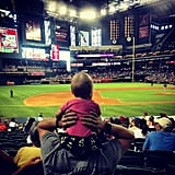 Stephen had Mavi on his shoulders during a baseball game in June 2014.