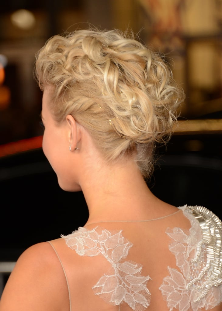 The back of her hair was curled and pinned into a whimsical fauxhawk style.