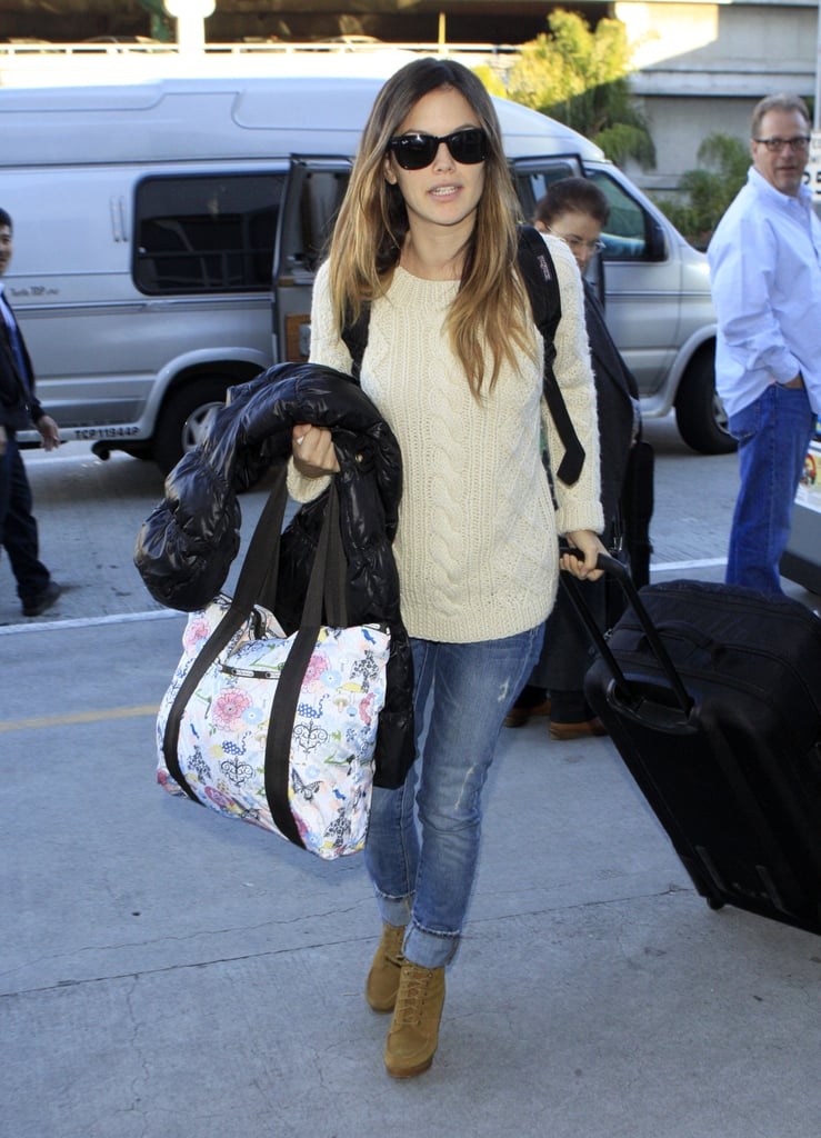 Rachel Bilson pulled her carry-on bag and toted a LeSportSac headed to catch a flight out of LAX yesterday. She's been laying low home in LA since rekindling her relationship with former fiancé Hayden Christensen last month. The couple hasn't commented on whether their wedding plans are back on, though they managed to avoid landing a spot in our 2010 year in breakups slideshow. She and Hayden have a complicated love story, though it's Robert Pattinson's real-life best friend Tom Sturridge who is romancing her in the trailer for Waiting for Forever. Next up on the big screen is BFF and Baby, which Rachel shot alongside Krysten Ritter in the Fall, and Bilson will be making her return to the small screen thanks to O.C. creator Josh Schwartz as well.