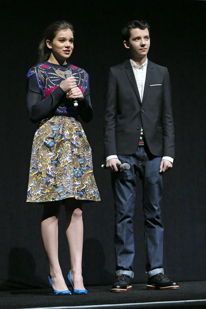 While on stage during CinemaCon, Hailee Steinfeld looked fashion-forward in a mixed-print ensemble and blue pumps.