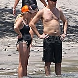 Reese Witherspoon pregnant in a swimsuit with Jim Toth.