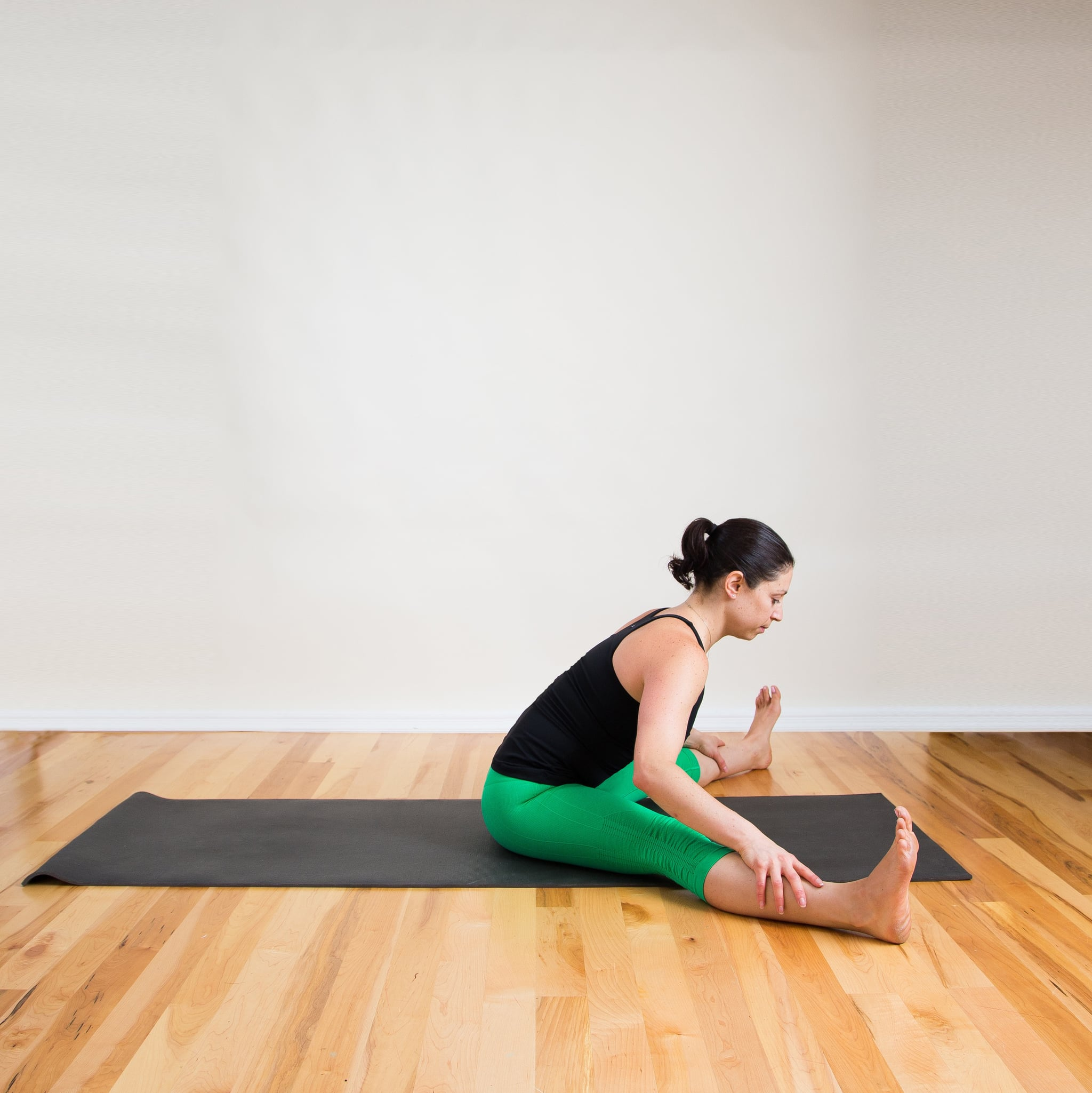 This Is the Yoga Pose to Do If You Want to Work on Your Arms and Butt at the Same Time