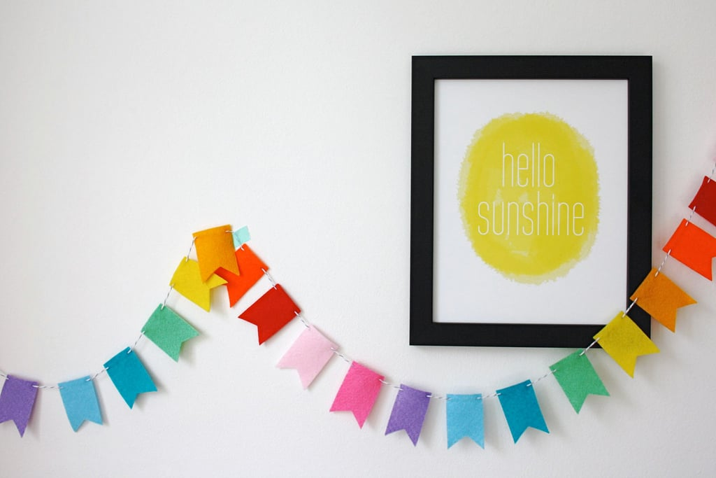 Go bright and simple with this yellow hello sunshine print ($25).