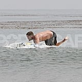 Robert Pattinson splashed in the ocean shirtless.