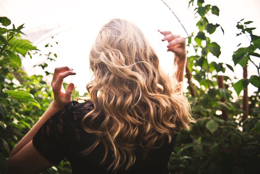 Tip #3: Let It Set One of the biggest mistakes we make when trying to create a lasting curl is to use a tool like a curling iron, wand, or flatiron. These are great for ease of use and will give a nice temporary curl, but those curls will drop very quickly, especially if you have fine hair, or very heavy, long ends. You can still use your heated tools for a longer lasting curl, just add in one extra step. Clip each tonged coil to your head as you curl it, letting it sit on the head until it's completely cooled down. This goes back to point number one: you need to change the state to set the curl. Speed things up with the cool-shot button on your hair dryer, and only shake the hair out when it's stone cold. Your curls will last twice as long this way. Tip #4: Leave Your Rollers In For as Long as Possible Hot rollers are great for retro waves and styles that require lots of body, but most tutorials tell you to leave them in for only 10 or 20 minutes. This is fine if you're using them for volume or to smooth hair ready for an updo, but if you want curls that last through a night of dancing, then you need to let those hot rollers cool completely . . . which in our experience can take up to a couple of hours in thick or long hair. Plan ahead and keep your rollers in as long as you can. And don't forget to use a styling product! Tip #5: Adjust Your Cut (If You Can) If you have particularly thick or long hair, you'll probably struggle to get a DIY curl to stay in. The longer your hair gets, the heavier it is and the harder it'll be to get a uniform curl to stay. You may find the ends go frizzy and curly, but the lengths fall flat. You have a few options to fix this. Firstly, get lots of layers chopped in — especially around the front — to reduce weight and give the hair some bounce. You should find that these shorter sections curl better. Secondly, chop your hair a few inches shorter.  The simple truth is super long hair will not curl easily if it's naturally straight. Fin