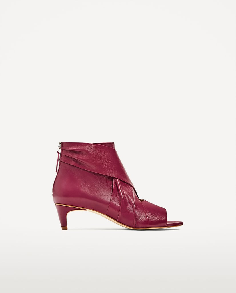 Zara tries out the look with its Leather Ankle Boots ($119)