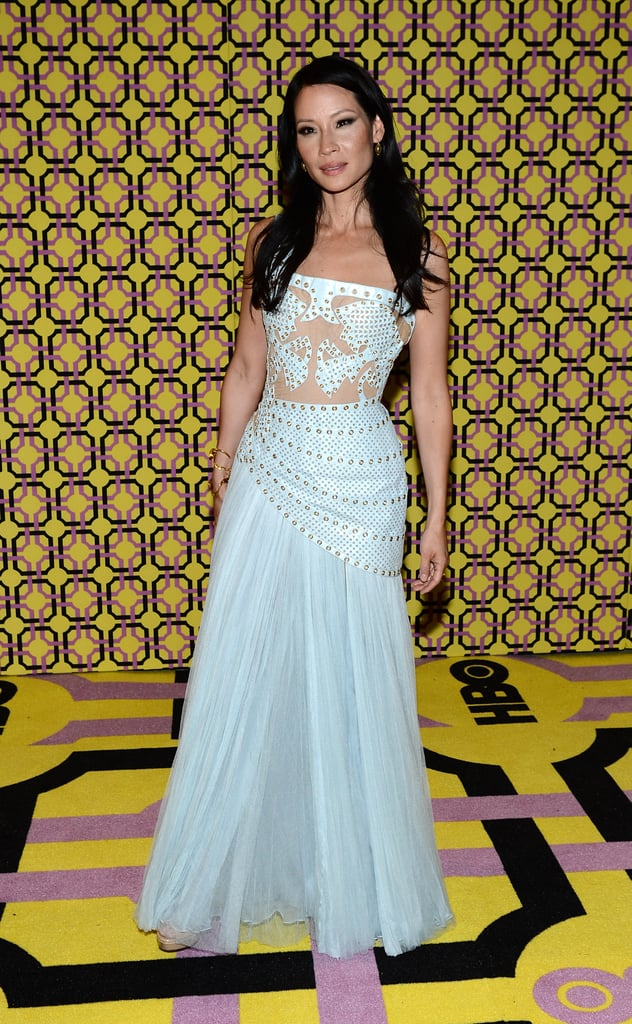 Lucy Liu traded one Versace for another at the afterparty, opting for a powder-blue strapless, adorned with rivets.