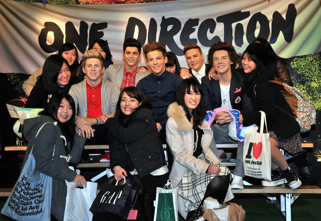 """The Madame Tussauds Wax Museum in Tokyo caused quite the sensation among a group of Japanese women when the museum unveiled its new wax figures of One Direction. The excited girls kissed, hugged, and took selfies with the faux boy band members, with one lucky lady getting a chance to perch herself atop fake Louis Tomlinson's lap. However, the ladies better be careful about their fondling of the wax celebrities, as Justin Bieber fans had to learn the hard way that the figures aren't meant to be touched so roughly. The Madame Tussauds in New York recently had to remove its figure of Justin from the museum after it had gotten """"damaged and warped"""" because of so many eager fans fondling the wax statue. Lucky for them, the museum has reportedly promised to replace the teen idol's statue with a new version."""