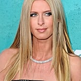 Nicky offset her strapless neckline with an eye-catching diamond necklace.