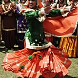 An Indian girl twirls in her Punjabi dress during  the Teej festival celebrations at Khalsa college for women in Amritsar.