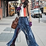 A floaty skirt got a Winter twist with chunky black booties and a colorblocked BCBG moto jacket.