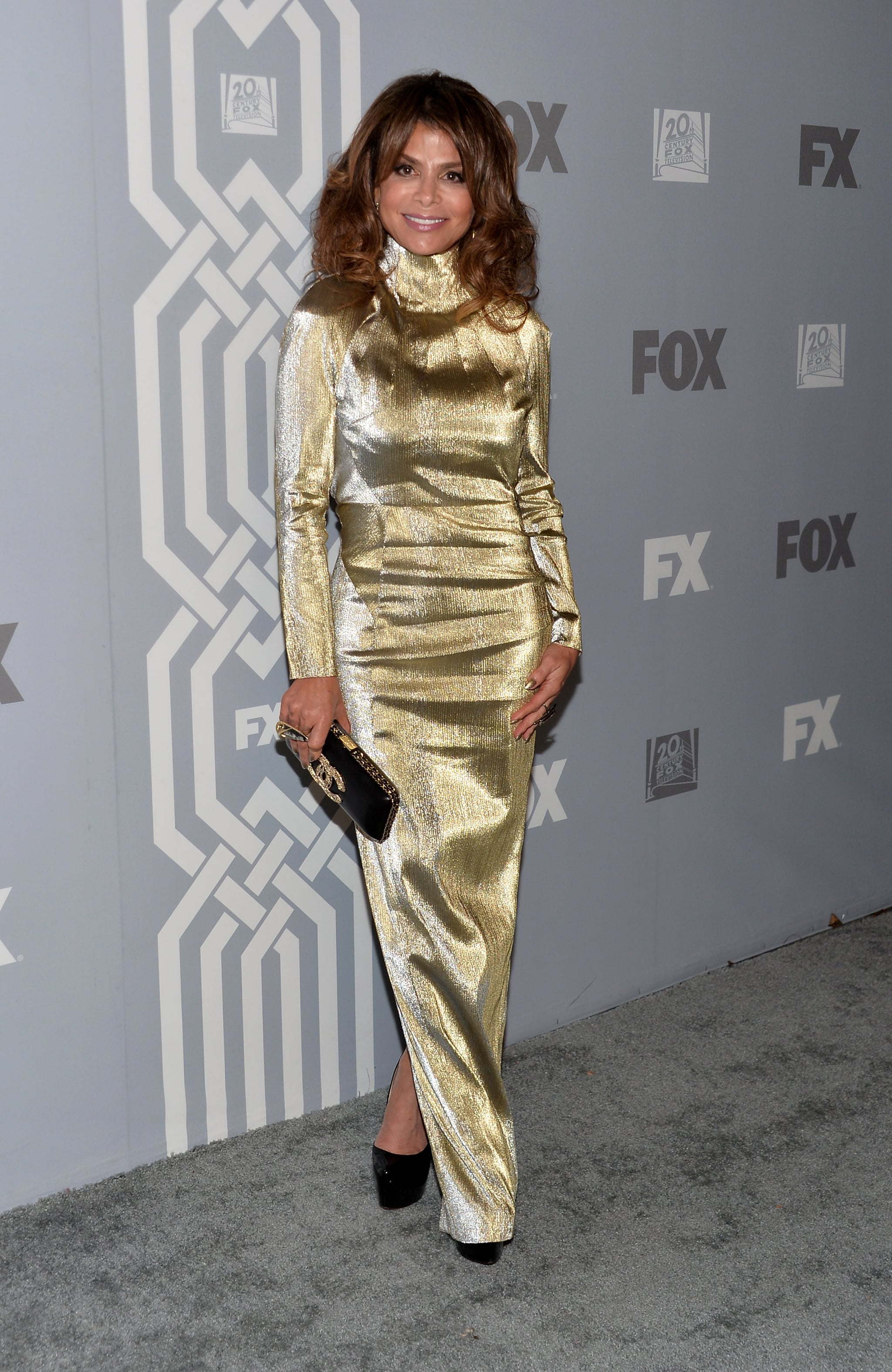 Paula Abdul celebrated at Fox's post-Emmys party in a gilded long-sleeved dress.