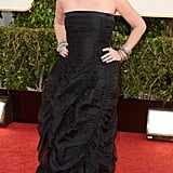 Debra Messing, mom to Roman, 8, looked smashing in a strapless black gown.