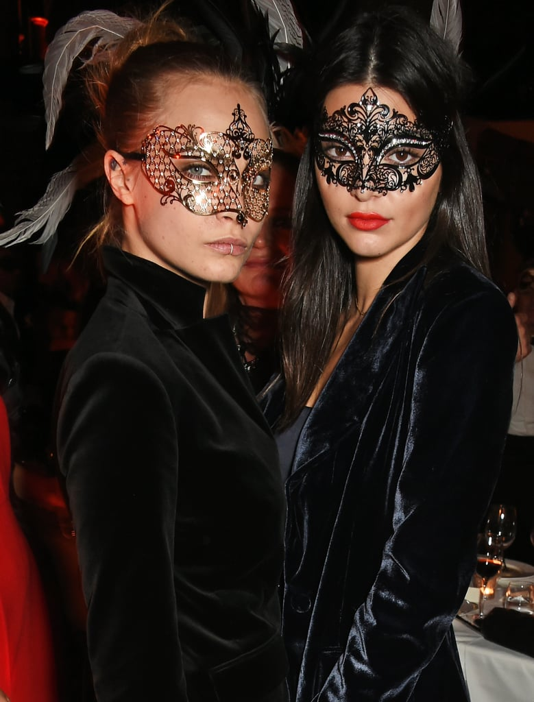 "Cara Delevingne and Kendall Jenner sure know how to party. On Friday, the model pair attended a birthday party for designer Roberto Cavalli's wife, Eva, in London. Kendall and Cara kept things sexy and mysterious in crop tops and masks and also took to Instagram to document their evening. Earlier that day, Cara gave a nod to their nickname with a snap of her and Kendall hugging, writing, ""The chronicles of CaKe.""  The fun outing comes on the heels of a busy month for Kendall. After hitting the runway at the Balmain show, she graced the cover of the November issue of Cosmopolitan alongside her famous sisters, and most recently, she and Cara were spotted hanging out with St. Vincent during Paris Fashion Week. Keep reading to see more photos from Cara and Kendall's night out."