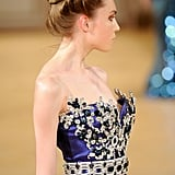 A detailed bust at the Tony Yaacoub Haute Couture Fall 2013 show is especially ornate when viewed closer.