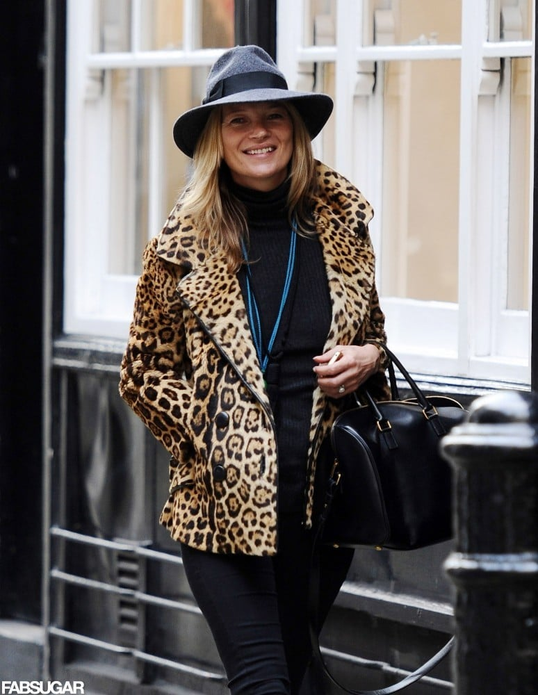 Kate smiled for the cameras while walking down the street.