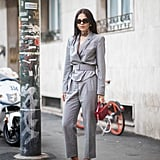 Suit up in a grey look, black sandals, and matching sunglasses.