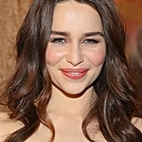 """""""When I'm working with younger actresses, it's always nice to keep them clean and fresh, so their own features show up and are not muted out,"""" Chanel makeup artist Jillian Dempsey said. """"I wanted to keep her effortless-looking. Emilia has beautiful porcelain skin, so I didn't really need to cake on a ton of foundation or powder."""" So Dempsey just added a thin layer of Chanel Vitalumière Aqua Ultra-Light Skin Perfecting Sunscreen Makeup ($45). To get her khaki-and-bronze eye makeup look, Dempsey outlined her peepers with Chanel Stylo Yeux Waterproof Long-Lasting Eyeliner in Khaki Précieux ($30), a khaki gold-green. She then layered on Chanel Limited Edition Quadra Eye Shadow in Séduction ($59). """"I didn't do a traditional smoky eye, but I wanted her eyes to have a little drama — to look ethereal, and worn in, and dewy, and luminescent,"""" Dempsey explained. Her lashes were finished with Chanel Inimitable Mascara ($30) and short-length individual lashes on three quarters of her eye.  Emilia's lips were done up in Chanel Rouge Coco Hydrating Crème Lip Colour in Mystique ($34), a dusty rose color. """"I like to apply a nude lip liner, like Chanel Le Crayon Lèvres Precision Lip Definer ($29), after I put on the color so it doesn't look too perfect,"""" said Dempsey. """"I call it my 'scribbling method': You put on your lipstick color with a brush, so it looks like you're staining the lips at first. Then you take your liner, and you push out on the upper corners of the mouth to build a shelf where you want the color to go, moving with the natural shape of the lips. Then you go back in with your lip color."""""""