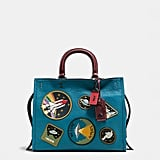 This Rogue bag in natural pebble leather with space patches ($895) will help you channel your inner martian.
