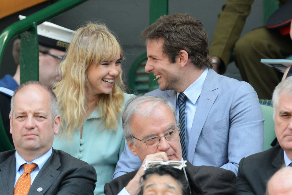 Couple Suki Waterhouse and Bradley Cooper shared a laugh during the men's singles final on July 7.