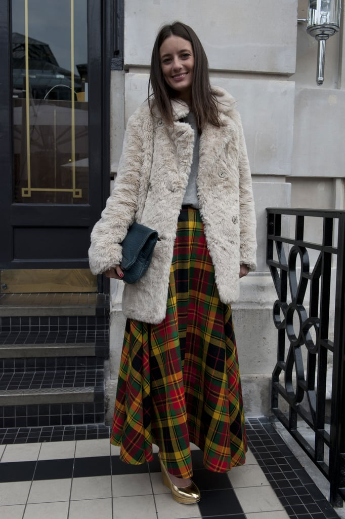We love the begs-to-be-touched texture of her coat and the prep-school plaid of her maxi.