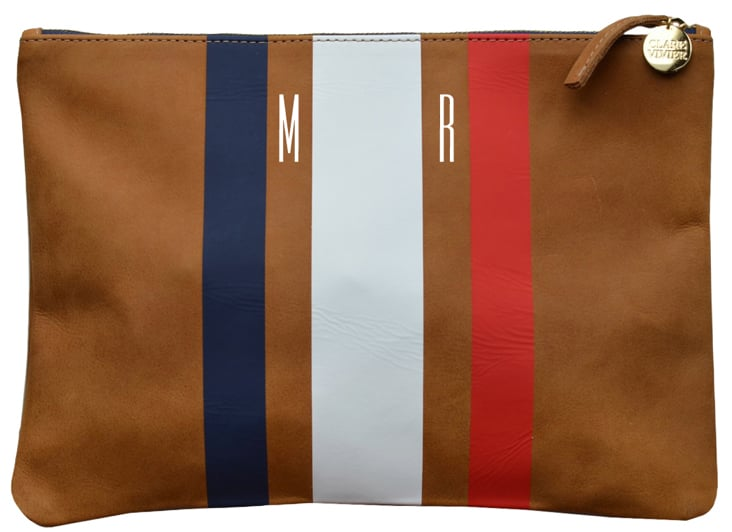 We love the classic stripe on this Clare Vivier flat clutch striped ($184), but the best part is you can personalize it with gold initials.